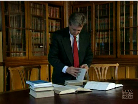 Lawyer looking through legal books. Image taken from 'A Guide to Legal Materials: Programme 1' produced by Sheffield University Learning Media Unit, 1994.