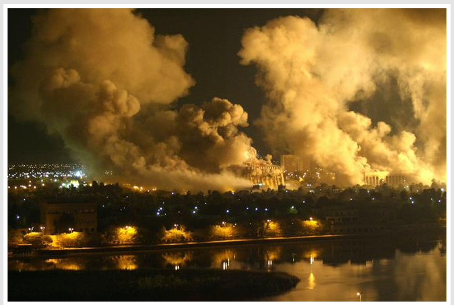 Image of smoke billowing from the presidential palace compound in Baghdad 21 March 2003 during a massive US-led air raid on the Iraqi capital.