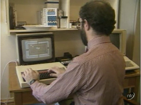 Image of a man playing a computer game back in 1984.