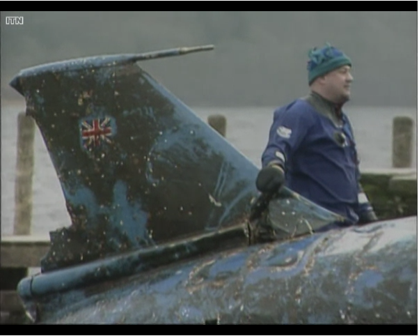 Still from a news report on the raising of the wreckage of Sir Donald Campbell's 'Bluebird' from Comiston Lake. Image shows diver Bill Smith who discovered the wreckage back in 2000. Report by ITN in 2001.