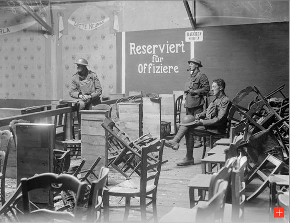 Image of three members of the patrol of the Loyal North Lancashire Regiment in a wrecked interior of a German cinema theatre in Cambrai. Taken during the First World War on the 9th October 1918.