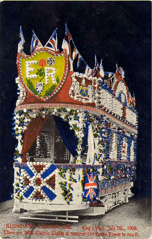 """Image of a postcard showing an illuminated electric tram for the Royal Visit of King Edward VII and Queen Alexandra. At the bottom of the potscard """"Illuminated electric car. King's Visit July 7th, 1908. There are 3000 electric lights and requires 150 horse power to run it."""""""