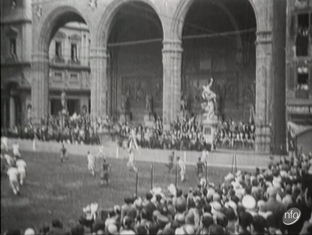 A still image taken from a short film showing a football match being played in the Piazza Vecchio in Florence, Italy in 1931.