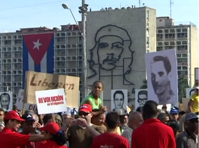 A image of Cubans in a May Day rally in Revolution Square, Havana.