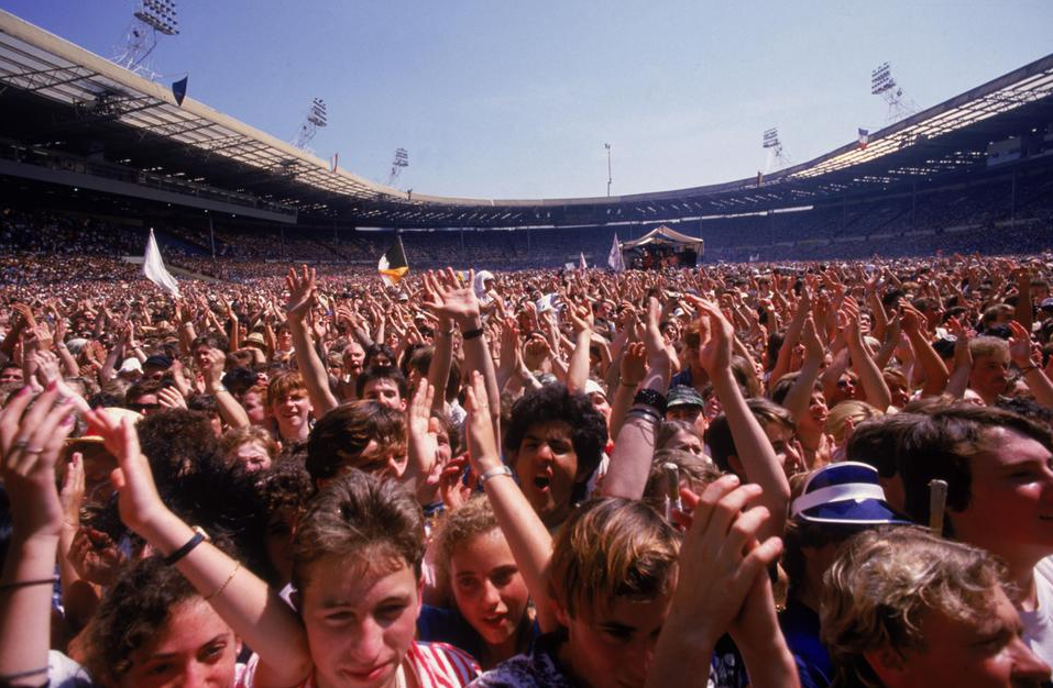 A photograph of the crowd at the Live Aid charity concert, Wembley Stadium, London, 13th July 1985.