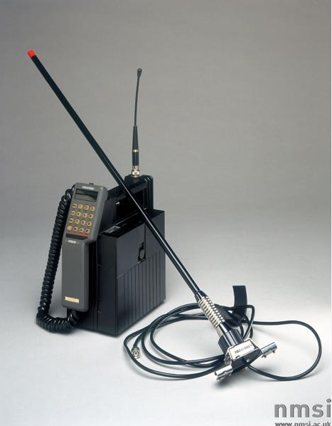 An image of a transportable mobile telephone, complete with accessories and instruction manual, by Vodafone, 1985.